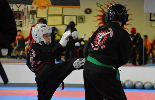 Two Excel students sparring