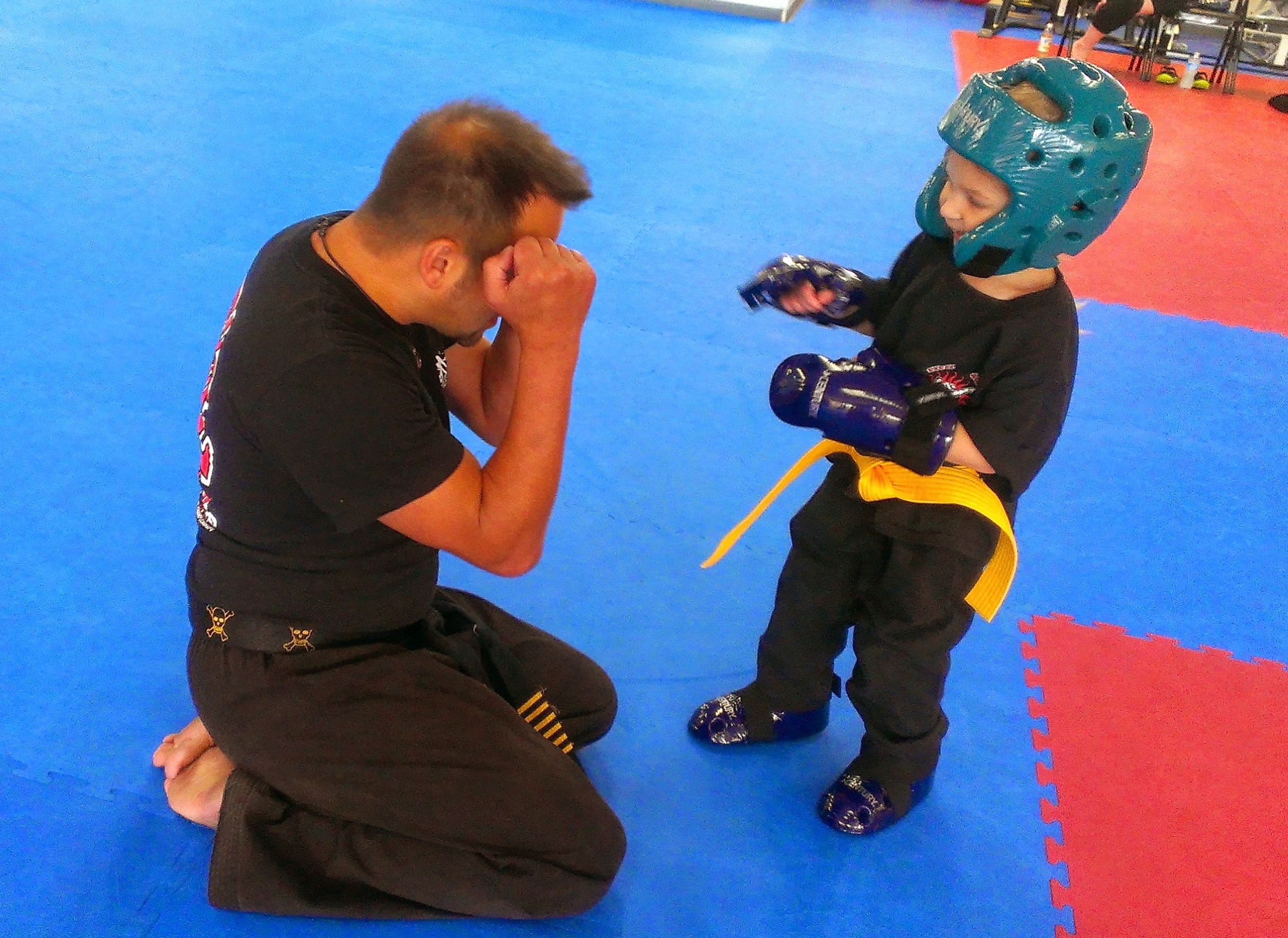 Head instructor sparring with young student